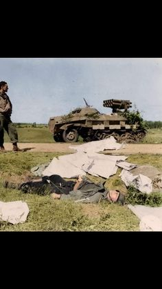 An american GI and a dead german next to a rocket halftrack. Location unknown