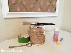 DIY Bulletin Board Make-Over with chalk paint and whimsical pearlescent polka dots in white and pink with burlap | remodelicious.com