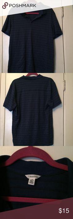 Calvin Klein Polo Never worn, Calvin Klein polo. 100% cotton navy blue & black stripe. Super soft shirt. Size large Calvin Klein Shirts Tees - Short Sleeve