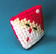 santa kissie- Squeeze his cheeks and he'll give you a (Hershey's) kiss!   made with plastic canvas