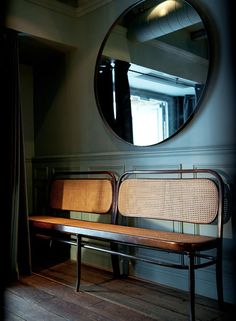 bentwood rattan bench : teal walls : huge round mirror