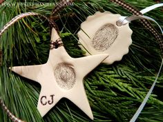 DIY Crafts | Christmas | These child thumbprint ornaments make the perfect sentimental Christmas gift for family - especially grandparents!