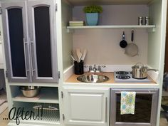Play kitchen from an entertainment center. Love this!