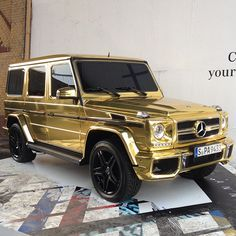 Gold Mercedes. I just betcha that Arnold Schwartzenegger has one of these stashed somewhere.