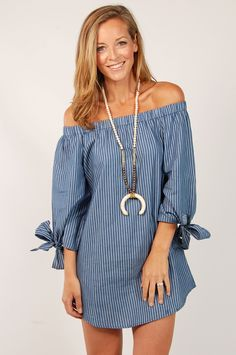 - Vertical stripe off the shoulder dress with elastic neckline and tie sleeve detail - Color: Denim - 65% cotton, 35% poly - Hand wash + hang dry - Item # LVD61066 - We love the cute bow detail on thi