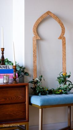 Bring your door décor indoors! Styled here with a pop of color and fresh flowers, our door décor signs can easily be displayed against your favorite table or ottoman. Shop the look now on our website. #daysofeid