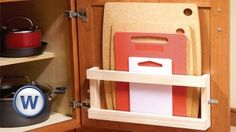 Store Cutting Boards in Your Cabinets with a Magazine Rack - 60+ Innovative Kitchen Organization and Storage DIY Projects