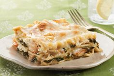 No-Fail Baked Seafood Lasagna recipe:Move over marinara. Our creamy Parmesan sauce pairs perfectly with spinach, shrimp and crab for a new take on lasagna that's an easy way to get your family eating seafood. Seafood Lasagna Recipes, Seafood Bake, Seafood Dishes, Pasta Dishes, Pasta Recipes, Cooking Recipes, What's Cooking, Kraft Foods, Kraft Recipes