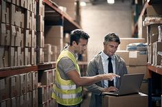 Shot of coworkers using a laptop in a distribution warehouse - stock photo #1331961