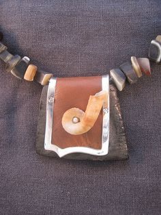 Go With the Flow Necklace with buffalo horn leather, sterling silver and shell. www.e-bu-jewelry.com