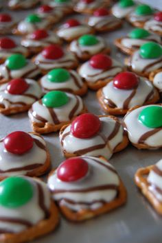 Super easy Christmas baking and one of my favorites for gift-giving.  Small pretzels (round, square or tiny twists), Hershey's Kisses Hugs, red & green M&M's.  Parchment paper makes clean-up a breeze!