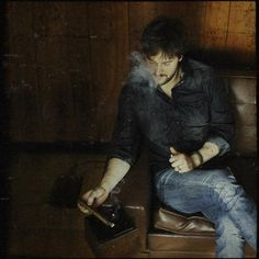 Eric Church smoking a cigarette (or weed)