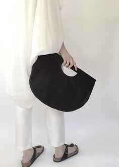 A woman's handbag and jewelry line focused on minimal elegant form that is both…