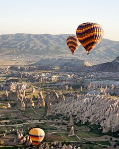 Turkey    Soar by hot-air balloon over otherworldly rock formations, called fairy chimneys, in Cappadocia. Some of these bizarre stones are even carved out and inhabited. Stay in a cave hotel for the full experience (kapadokyaballoons.com).