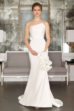 Sleek, modern silk crepe wedding gown. Try it on only here at Felicé Bridal in all of Colorado!