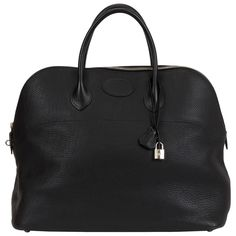 Hermès Ex-Large Travel Black Bolide Bag   From a collection of rare vintage top handle bags at https://www.1stdibs.com/fashion/handbags-purses-bags/top-handle-bags/