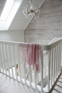 You don't have to redecorate your hallway to match your white frame roof window but it does make a great finish, doesn't it?