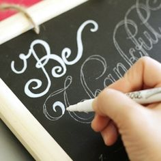 use a white sharpie on the black chalk board for the signs. we can write in chalk  useing stencil lettering, then fill in with sharpie and erase chalk marks