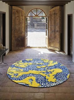 Round Blue China wool rug, applying Chinese porcelain motifs to a plush floor covering.