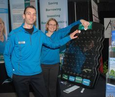 Jeff Thomson and Sarah MacGillivary, of Libro Financial Group, showed off the Plinko game to visitors at their booth at the St. Thomas Home, Garden and Outdoor Living Show Sunday at the Timken Centre. Where the tokens landed determined what free prize visitors got at the booth. Buy this Plinko Game at http://PrizeWheel.com/products/plinko-game/mini-plinko-game-black/.