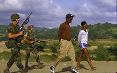 troops escorting suspected members of the People's Revolutionary Army of Grenada, 1983 Invasion Of Grenada, Democratic Election, Life Pictures, Us History, Military History, Military Gear, Historical Pictures, Us Army, Irons