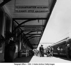 Signs in English and Afrikaans, in Wellington railway station, South Africa, enforcing the policy of apartheid or racial segregation, c. 1955 Photo credit: Evans / Three Lions / Getty — at Wellington railway station. South African Railways, Black History Books, Sign Image, Jim Crow, Apartheid, Japanese American, African History, History Facts, Stock Pictures