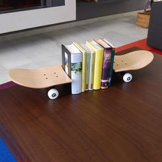 Instagram #skateboarding photo by @skatehomefurniture - Skateboard bookends a perfect gift idea for any aspiring skateboarder. Could also be used to hold up skateboard magazines or books.  Available on skate-home.com Worldwide shipping.  #loft #modern #interior #decor #design #inspiration #giftidea #unique #homedecor #inspire #home #room #decoration #passion #love #instalike #instagood #bookends #nyc #california #france #skate #skateboard #skater #skateboarder #skateboarding. Support your…