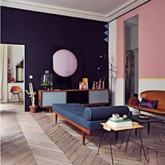 I love the charcoal wall with the pink.  Very Chic!