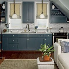colored kitchen cabinets~~~ looks like an efficiency kitchen - very cute!