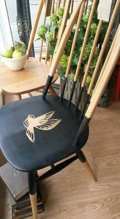 An old Ercol Quaker chair, repurposed. www.facebook.com/paintedladyswindon
