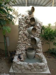 22 Unique DIY Fountain Ideas to Spruce Up Your Backyard Whats more soothing than a water fountain? A DIY version that wont break the bank. Backyard Water Fountains, Outdoor Ponds, Garden Water Fountains, Small Fountains, Ponds Backyard, Water Garden, Garden Pond, Water Fountain Design, Bamboo Fountain