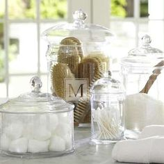 18 Bathroom Updates You Can Do in a Day—YOURSELF - Be Spa-Minded  Details can be delightful. Why keep your cotton balls and Q-tips under the sink when you can display them in pretty glass jars like these? Or, if glass in the bathroom seems like an invitation to disaster, score a few low-profile rattan baskets to store your wares.