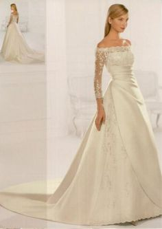 Another off-the-shoulder lace wedding dress.