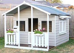 Aarons Outdoor Living - Castle Cubby House with Cubby Servery!  Great for a mud pie cafe' or the school chalkboard!