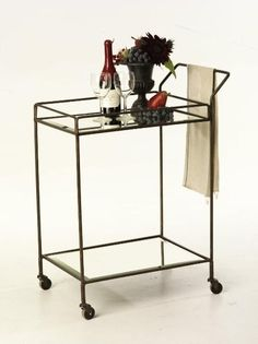 "This chic and simple bar cart is a great piece to have year round, not just to wheel out for when guests come.  Two levels of storage and four wheels with a bronze finish.  Measures 23"" length x 17"" width x 36"" tall.  Click image to enlarge. *** Please note this item is made by hand and variations in finish are intrinsic to the beauty of the piece and has been done intentionally to give an antiqued look. Mirrored pieces may have antiquing on the mirrored portions and if you want a newer ..."