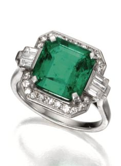 An Art Deco Platinum, Emerald and Diamond Ring, Circa 1925. The square emerald-cut emerald measuring approximately 10.47 by 10.25 by 6.05 mm., framed by single-cut and baguette diamonds weighing approximately .50 carat. #ArtDeco #ring