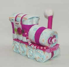 Diaper cake diaper locomotive + Pacifier Pink Windeltorte Windellokomotive + Schnullerkette rosa Welcome to Windeltorte.bayern ** A sweet Windellokomotive ** The Windellokomotive consists of the follo Pink Diaper Cakes, Nappy Cakes, Baby Shower Diapers, Baby Shower Gifts, Baby Gifts, Baby Presents, Blush Pink Wedding Cake, Gift Ribbon, Ribbon Crafts