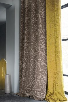 CASAMANCE - CAMARA Camara is a collection inspired by plants, in which embroidery of branch patterns sits alongside laminated velvets and pleated voiles; where jacquards and lampas welcome a shimmering viscose, which contrasts with the roughness of the wool and linen. Shades of vanillas, mother of pearl, grey, taupe, and lichen, stalwarts of the plant world, blend into more floral colours of plum and amber-yellow, turquoise and orange.