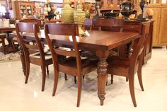 A very glossy and refined dining room table and chairs! | Houston TX | Gallery Furniture
