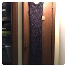 NWT - kar . a . van Black/Brown Maxi Dress. Beautiful new maxi dress with beaded bottom. V-neck and short sleeves.  Fully lined. Very long so would fit very tall gals.  100% Rayon.  Boutique. kat . a . van Dresses Maxi