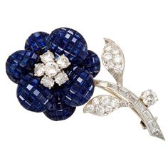 VAN CLEEF & ARPELS Invisibly Set Sapphire Diamond Flower Brooch