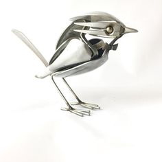 Bird with bowtie made of upcycled utensils and scrap metal.  Height: 4 inches  Length: 7 inches  Depth: 2 inches