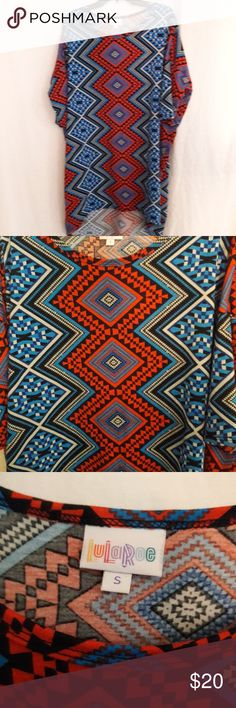 Lularoe Irma top Pre-owned Lularoe Irma top!!  For those who know this brand know how awesome these Irmas are. And this one has a gorgeous print and vibrant colors of blue, red, black and grey. Size is small. 96% polyester and 4% spandex LuLaRoe Tops Tees - Short Sleeve