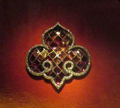 Fleur de Lys Stained Glass Brooch, 1987. Amethysts, garnets, tourmalines, diamonds, silver, gold.
