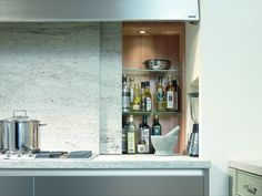 SieMatic kitchen. The false wall glides effortlessly and hides your clutter