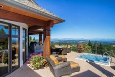 NANAIMO's HIGHEST HOME Belaria is the highest home in the glorious Harbour city and the back yard is the most unique being Mt. Benson. Amazing lines and distinctive rooms capture views of the lower mainland, including Mt.Baker. The elevator makes all three floors utilizable and the BC fir highlights all windows and creates warmth and elegance. | 3127 Northwood Road, Nanaimo Real Estate #hottubviews