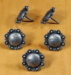 These stunning clavos have a durable pewter finish 1 diameter, protrudes Nail length: approx long Zinc alloy.will not rust. The clavos heads are made of a zinc alloy and will not rust Barn Door Handles, Door Knobs, Wood Slab Table, Steel Nails, How To Cut Nails, Rustic Hardware, Zinn, Nail Length, Nail