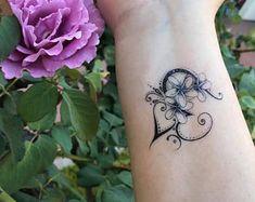 Tattoos Skull, Wrist Tattoos, Tribal Tattoos, Ribbon Tattoos, Side Tattoos, Flower Tattoos, Sleeve Tattoos, Tatoos, Foot Tattoos For Women