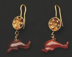 A Pair of Earrings with Dolphin Pendants  			  			  			Gold, carnelian.Greek, 3rd-2nd cent. B.C.