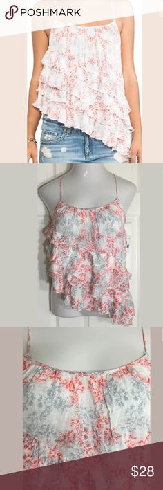 """Free People Red, White Floral•Ruffle•Tank Top Gorgeous floral, tiered, asymmetrical tank top with adjustable spaghetti straps. Bust: 35""""; length in the back from shoulder: 20""""-27"""". Smoke free home. Thanks for shopping my closet ! Free People Tops Tank Tops"""